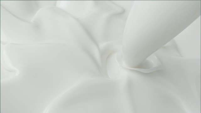 creamy milk splashing into spiralling ice cream mixture - close up - splashing stock videos & royalty-free footage