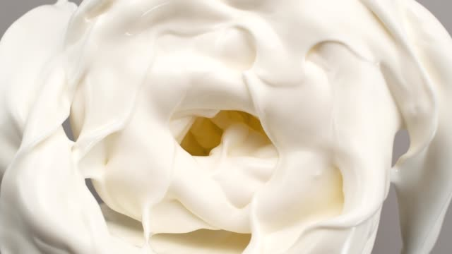 creamy milk swirling in blender. super slow motion - swirl pattern stock videos & royalty-free footage