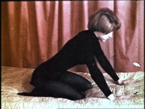 vídeos de stock e filmes b-roll de created for 'educational and scientific purposes' this film depicts a man and a woman demonstrating 'marital sex positions' / they lie fully clothed... - body de ginástica
