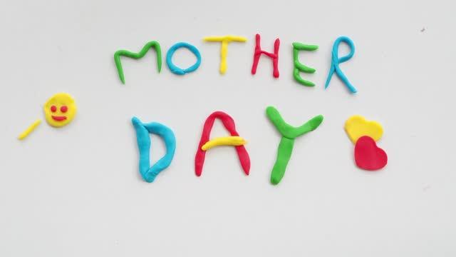 vidéos et rushes de création d'un acronyme commun pour l'animation de mouvement d'arrêt de pulpe. résolution 4k de stock de jour de fête des mères, dessin animé abstrait, animé, image animée-mouvement - évènement public
