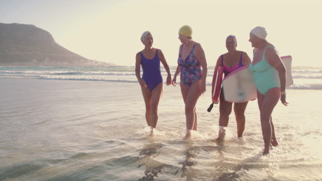 creating golden moments in their golden years - surf stock videos & royalty-free footage