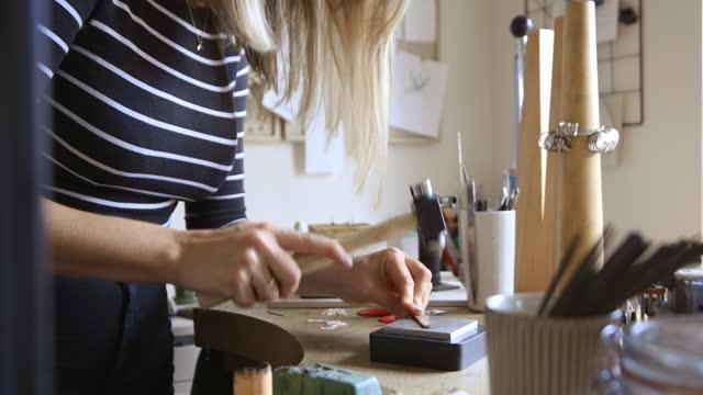 creating handmade jewellery - hammer stock videos & royalty-free footage
