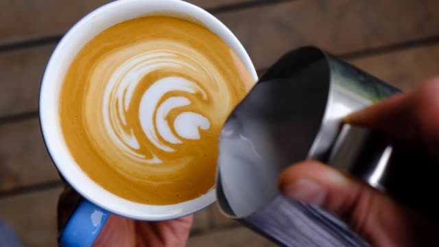 creating latte art on long coffee with milk - art stock videos & royalty-free footage