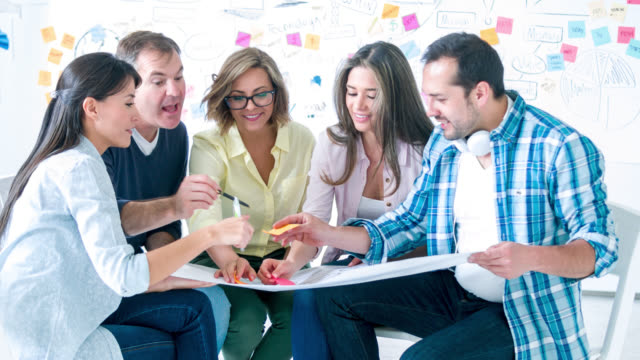 creative busines group brainstorming - employee engagement stock videos & royalty-free footage