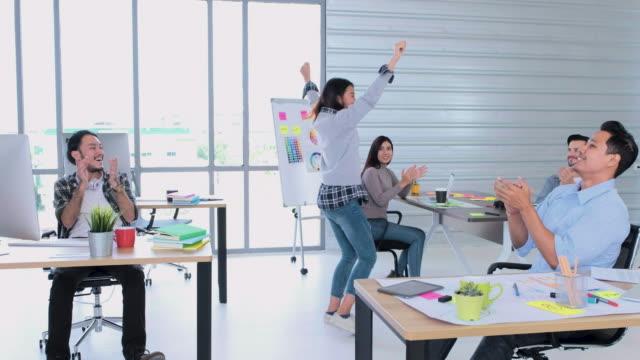 creative business office,female designer glad about got new project and get up and start dance in office with colleague celebrating a success - promotion employment stock videos & royalty-free footage