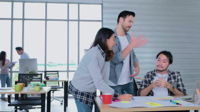 creative business office,group of diversity designer argument about work and one designer throw paperwork and walk out from meeting - annoying colleague stock videos & royalty-free footage