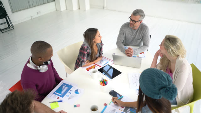 creative business people in a meeting - strategy stock videos & royalty-free footage