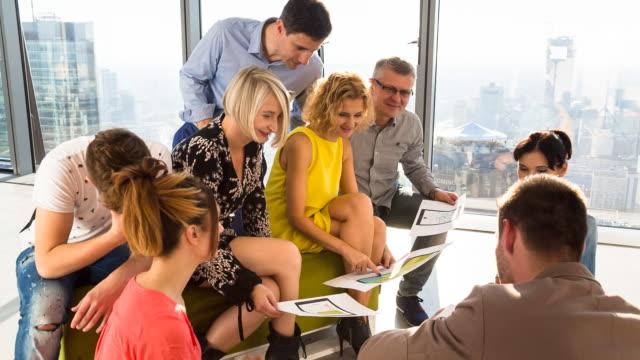MS PAN creative business team talking at meeting