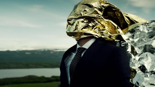 creative businessman concept. gold head full of ideas - materiale video stock e b–roll