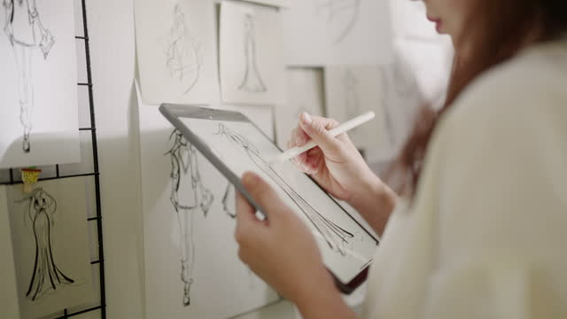 creative designer working drawing and sketching new ideas on digital tablet - fashion stock videos & royalty-free footage