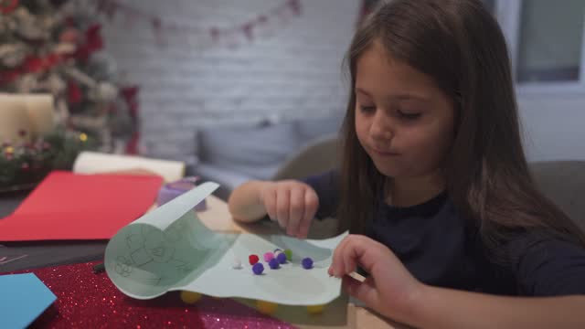 creative girl decorating with pom pom her new year greeting card - new year card stock videos & royalty-free footage
