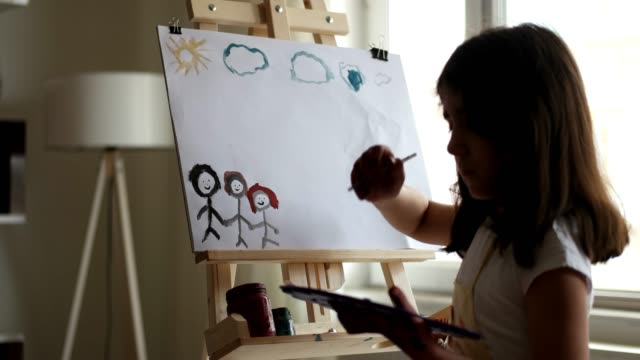 Creative little child painter in working process