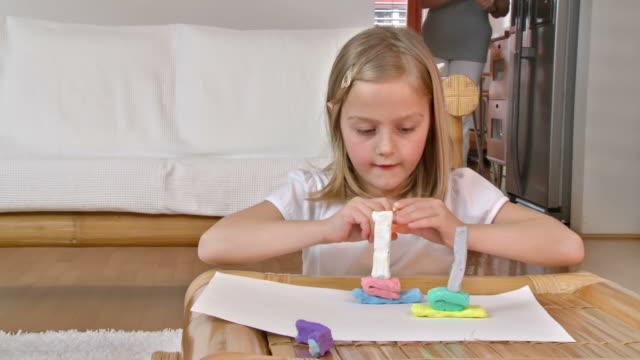 HD DOLLY: Creative Little Girl With Playdough