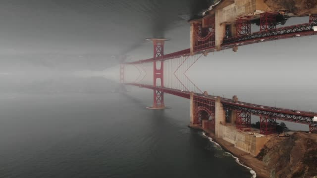 creative mirror effect of the golden gate bridge with stunning perspective effect. - vanishing point stock videos & royalty-free footage