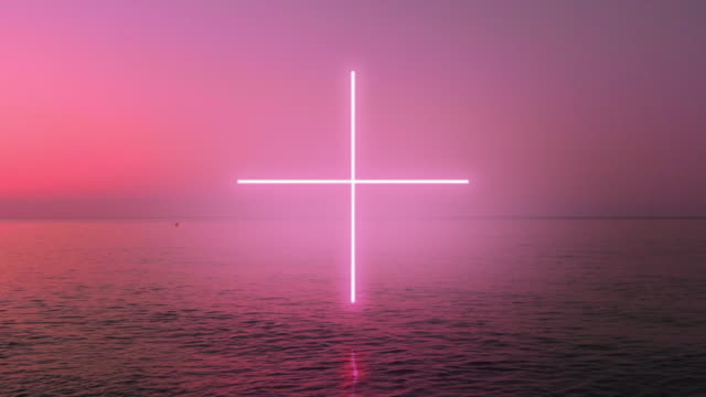 creative neon cross glowing during performance over the sea during sunrise. - horizon stock-videos und b-roll-filmmaterial