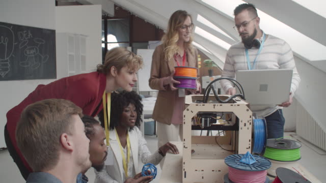 4K: Creative People Working By 3D Printer.