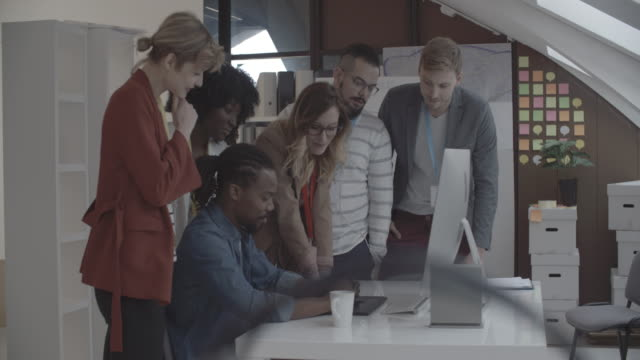 4K: Creative Startup Office Team Brainstorming.