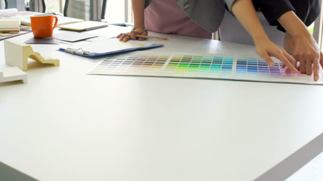 Creative Team See Color Chart On Table