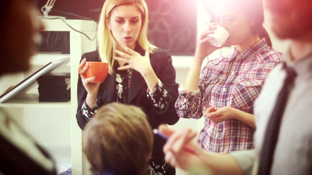 Creative teamwork group in the startup office: coffee break