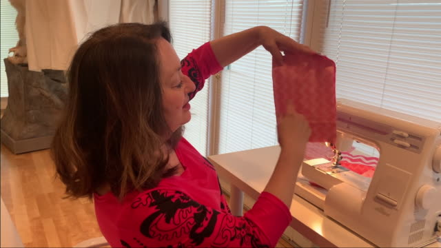 creative woman demonstrates how to sew to an online audience. - resourceful stock videos & royalty-free footage