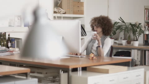 creative woman working in the office - soft focus stock videos & royalty-free footage