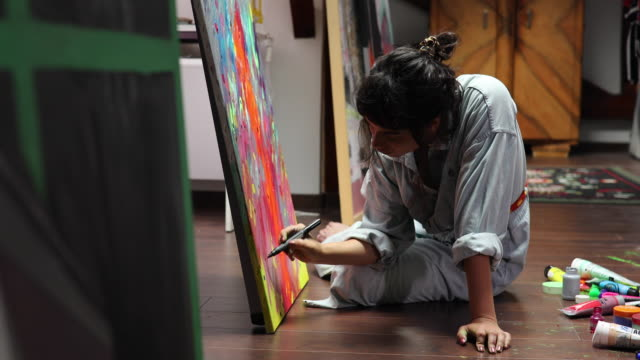 creative young artist painting at home - painting stock videos & royalty-free footage