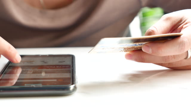 credit card on mobile phone - regalo video stock e b–roll