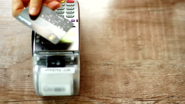 credit card payment with nfc technology in cafe. - paying stock videos and b-roll footage
