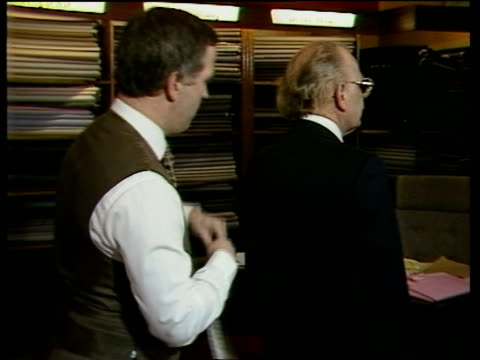 stockvideo's en b-roll-footage met credit files; england london saville row customer in tailor's shop another ditto man being shown cloth and measured zoom in measured with tape... - kleermaakster