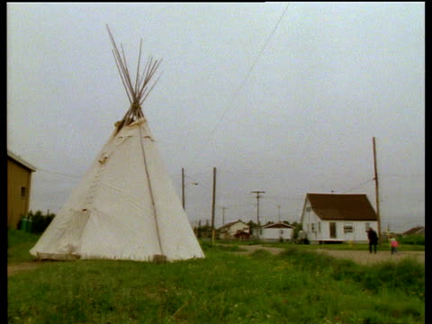 Cree reservation homes with large teepees in gardens