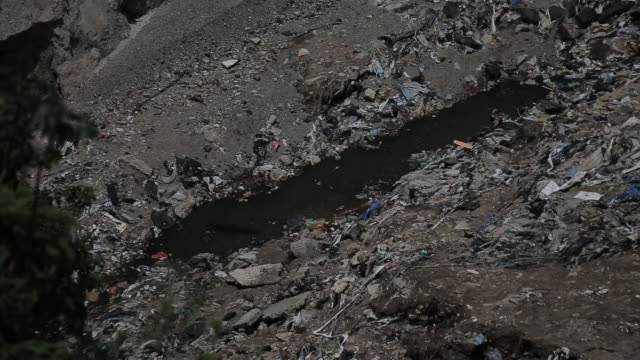 Creek flowing through dump in Guatemala