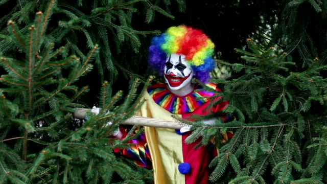 creepy clown hiding in tree with baseball bat - baseball bat stock videos & royalty-free footage