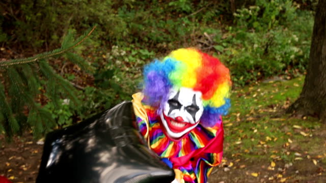 creepy clown in woods with balloons - clown stock videos & royalty-free footage
