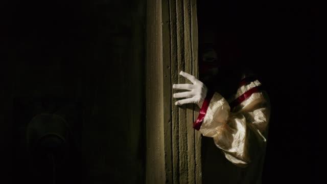 creepy clown peering around dark corner / cedar hills, utah, united states - clown stock videos & royalty-free footage