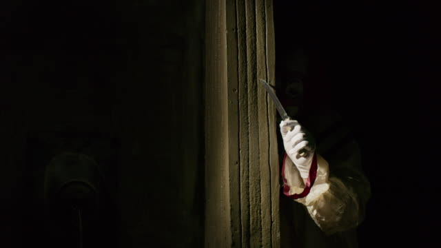 creepy clown peering around dark corner waving knife / cedar hills, utah, united states - spooky stock videos & royalty-free footage