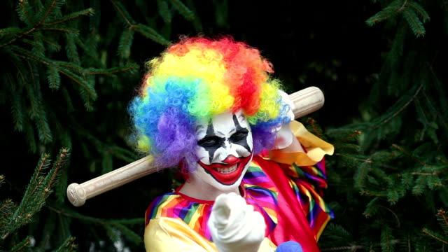 creepy clown with baseball bat - clown stock videos & royalty-free footage