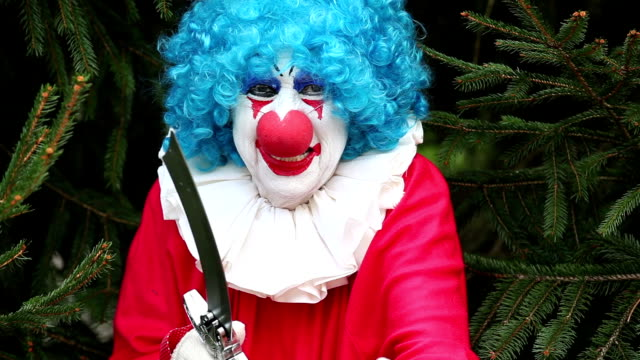 creepy clown with knife luring victim - knife weapon stock videos and b-roll footage