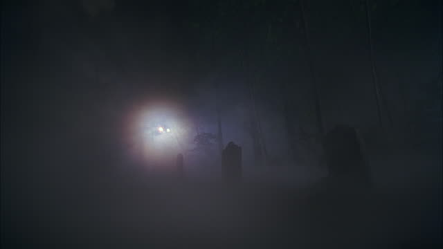 ws, creepy graveyard covered with fog at night - cemetery stock videos & royalty-free footage