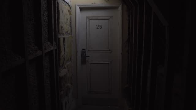 creepy hotel room in dark loft space coridor hallway number 25 door - spooky stock videos & royalty-free footage