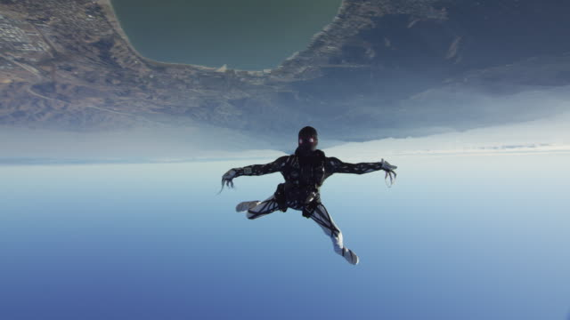 creepy skydiver performs free style - free falling stock videos & royalty-free footage