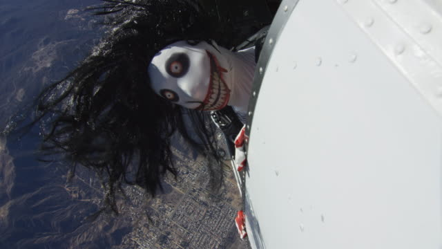 creepy skydiver pokes head out of airplane - horror stock videos & royalty-free footage
