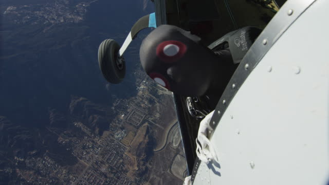 creepy skydiver pokes head out of airplane - ominous stock videos & royalty-free footage