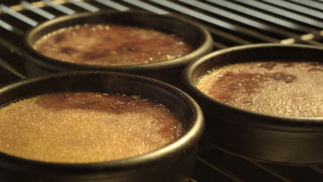 Creme caramel bakes in the oven.