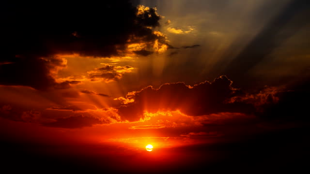 Crepuscular rays rays during sunrise in cloudy morning