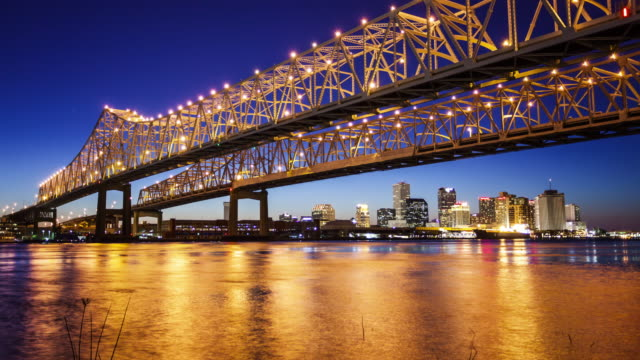 Crescent City Connection Bridge and New Orleans City Skyline at Night - Time Lapse