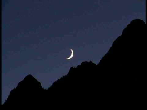 ms, crescent moon above silhouettes if mountain peaks, grand teton national park, wyoming, usa - grand teton bildbanksvideor och videomaterial från bakom kulisserna