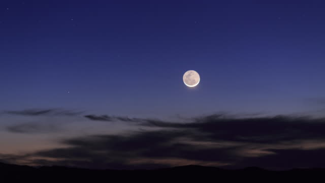 crescent moon in colorful morning twilight - cerro paranal stock videos and b-roll footage