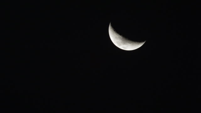 crescent moon in night sky. - crescent stock videos & royalty-free footage