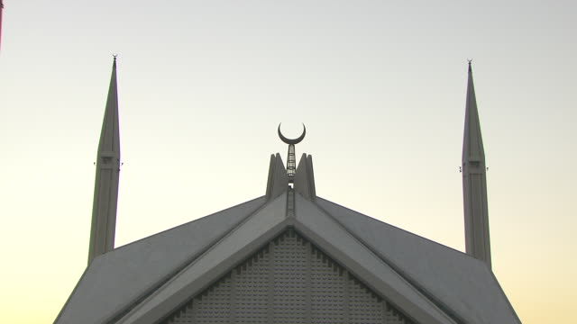 crescent moon roof detail of shah faisal masjid zo/ zi moon *sot call to prayer over loudspeaker sacred destination religion religious south asia... - praying stock videos & royalty-free footage