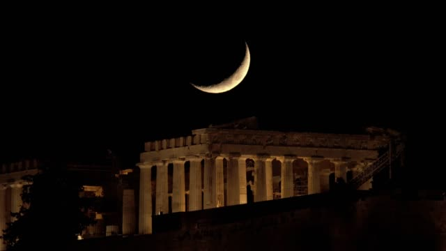 crescent moon setting over the parthenon in greece - parthenon athens stock videos and b-roll footage